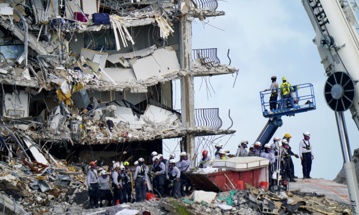 Workers search the rubble at the Champlain Towers South condo in Surfside, Fla., on June 28, 2021. (Lynne Sladky/AP Photo)