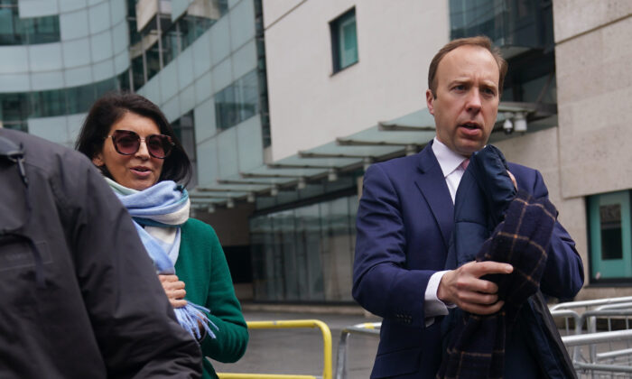 """Matt Hancock with adviser Gina Coladangelo (left) outside BBC Broadcasting House in London after his appearance on the BBC1 current affairs programme, """"The Andrew Marr Show,"""" on May 16 2021. (Yui Mok/PA)"""