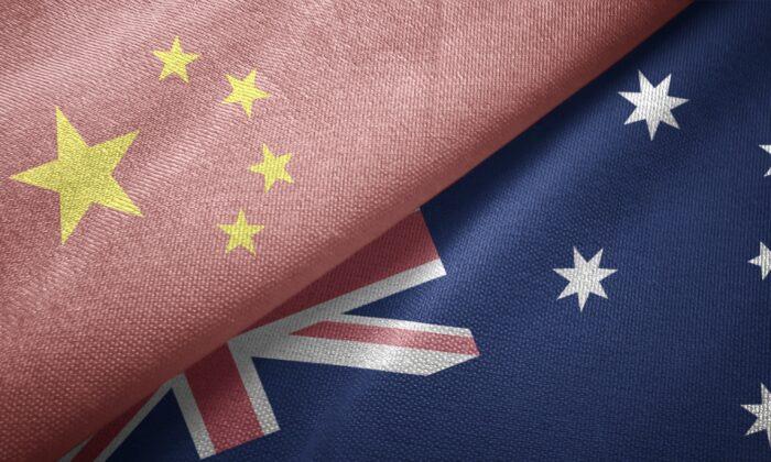 The Chinese Communist Party (CCP) flag encroaches onto the Australian flag. (Oleksii / Adobe Stock)