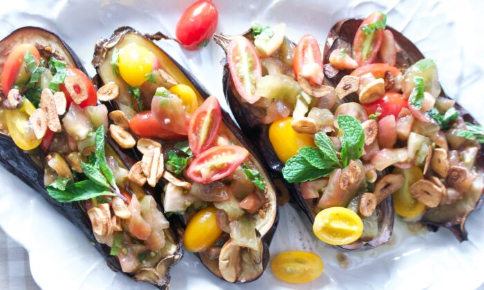Top simply roasted eggplant with a garlic-infused, vinegar-brightened medley of tomatoes.