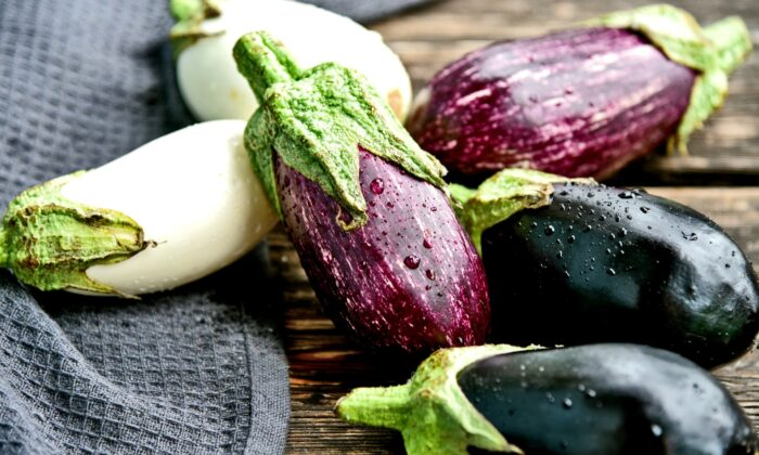 Come summer, eggplants show up at the markets in a variety of shapes, sizes, and colors. (PosiNote/Shutterstock)