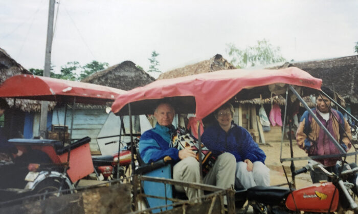 """The authors arrive in Puerto Maldonado, Peru, to begin their """"resort"""" adventure at the Tambopata Research Center. (Courtesy of Bill Neely)"""
