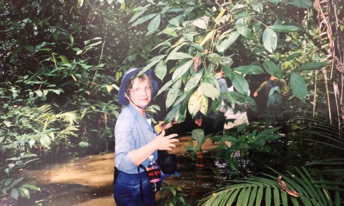 Bonnie Neely wades through flood water near the Tambopata Research Center in Peru. (Courtesy of Bill Neely)