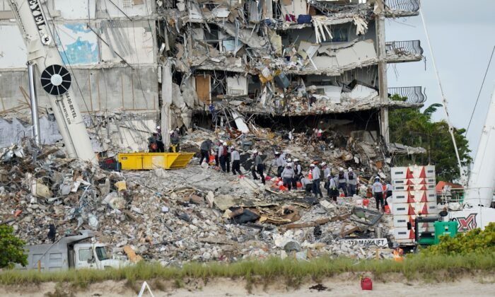 Crews work in the rubble Champlain Towers South condo in Surfside, Fla., on June 29, 2021. (Lynne Sladky/AP Photo)
