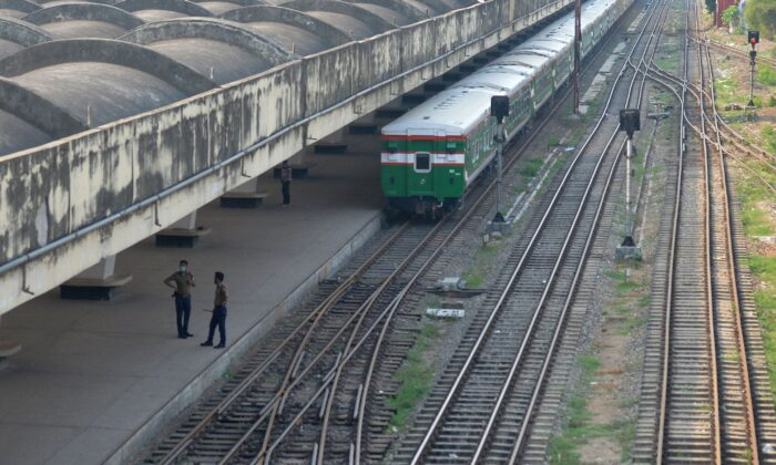 Security personnel seen at a deserted railway station  in Dhaka on April 19, 2021. (Munir Uz Zaman/AFP via Getty Images)