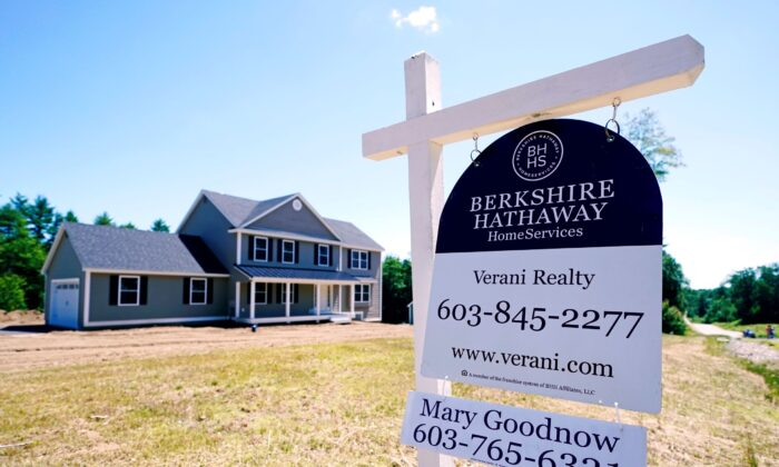 A real estate sign is posted in front of a newly constructed single family home, in Auburn, N.H., on June 24, 2021. (Aharles Krupa/AP Photo)