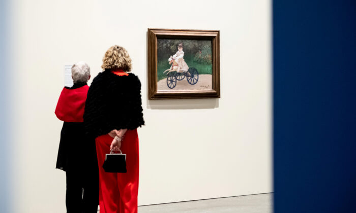 Visitors contemplating European Masterpieces from The Metropolitan Museum of Art, New York (Chloë Callistemon/QAGOMA).