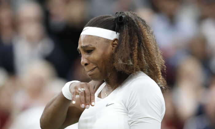 Serena Williams of the United States reacts after sustaining an injury during her first round match against Belarus' Aliaksandra Sasnovich during The Championships-Wimbledon 2021 at the All England Lawn Tennis and Croquet Club, London, UK, on June 29, 2021 (Peter Nicholls/Reuters)