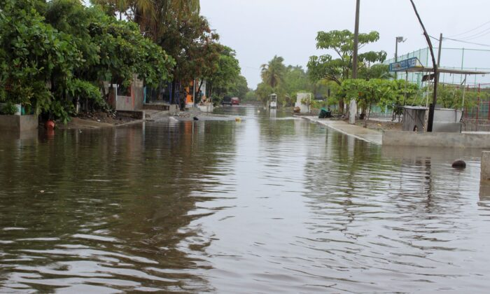 A flooded street is seen as Hurricane Enrique barreling northwards off Mexico's Pacific coast, in Manzanillo, Mexico, on June 27, 2021. (Stringer/Reuters)