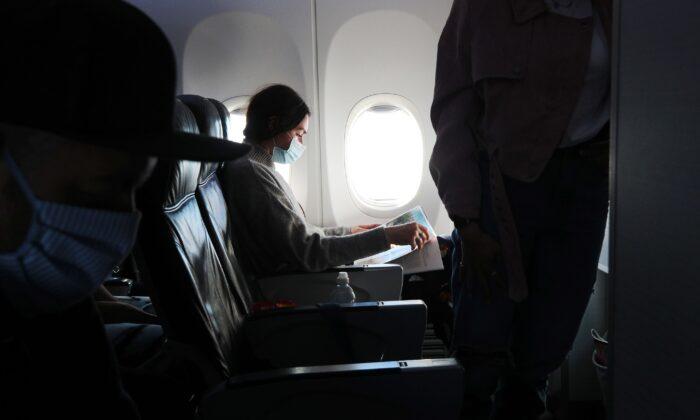 A woman on a plane, in an undated file photo. (Joe Pepler/PinPep/PA)
