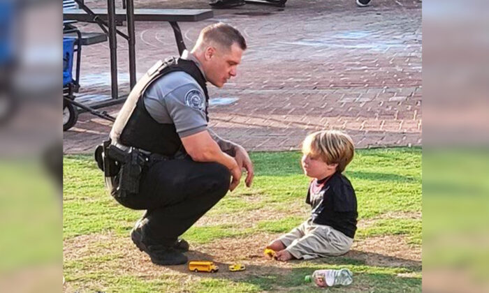 Officer Rolf Seiferheld of the Duluth Police Department talking to Harrison Humphries, 6, during the Food Truck Friday event in downtown Duluth on May 21. (Courtesy ofDuluth Police Department)