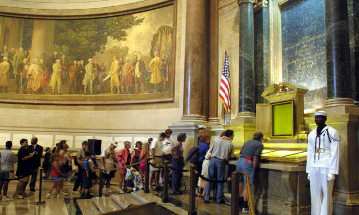 Visitors wait in line to view the original copies of the Declaration of Independence, the Constitution and the Bill of Rights at the National Archives in Washington, D.C. (Alex Wong/Getty Images)