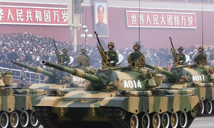 A convoy of People's Liberation Army tanks pass in front of Beijing's Tiananmen Square on Oct. 1, 1999, during a national day parade.   (Robyn Beck/AFP via Getty Images)