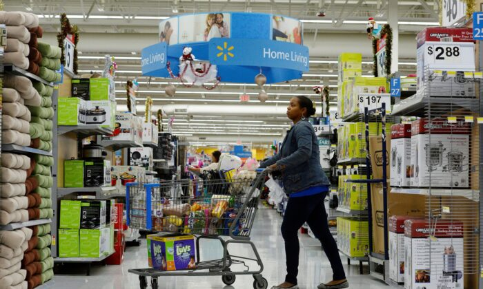 A customer pushes her shopping cart at a Walmart store in the Porter Ranch section of Los Angeles Nov. 26, 2013. (Kevork Djansezian/Reuters)