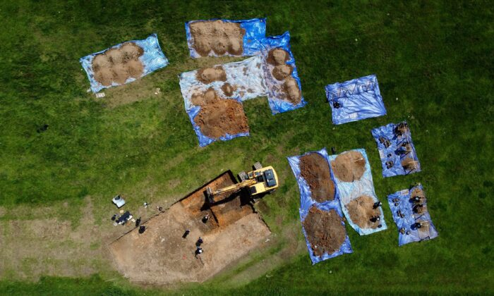 Archaeologists and American Defense POW/MIA Accounting Agency staff work to recover the remains of an American bomber crew, whose aircraft crashed at a site in Arundel in 1944, in Sussex, UK, on June 28, 2021. (Gareth Fuller/PA)