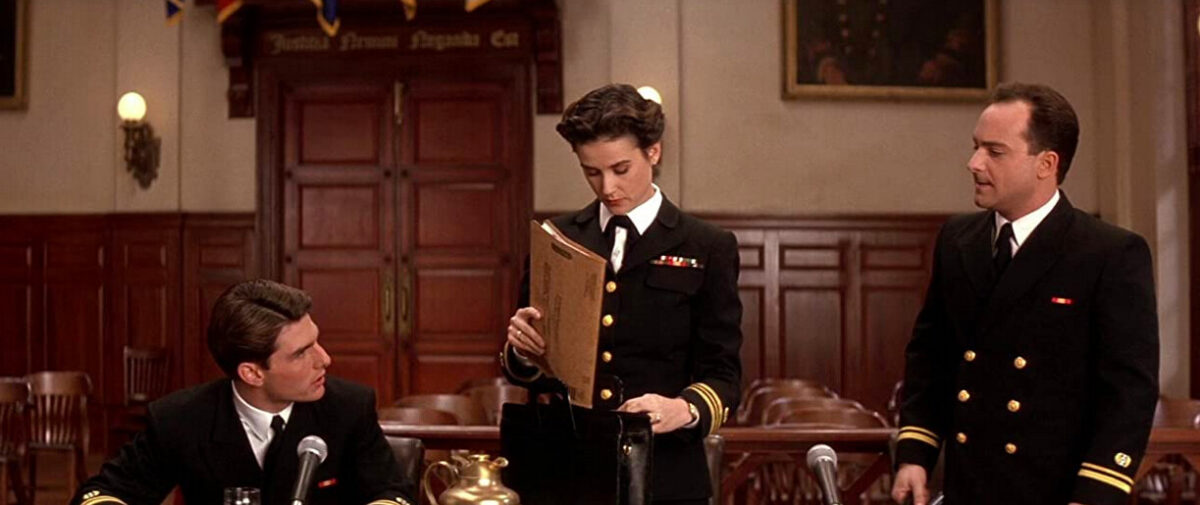 two men and a woman in a courtroom in A Few Good Men