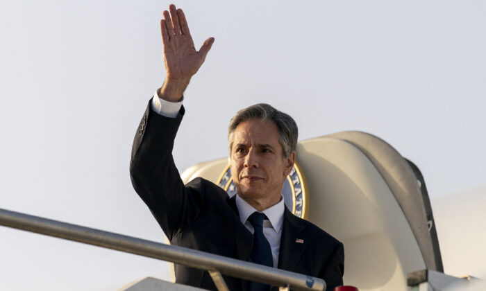 US Secretary of State Antony Blinken waves before boarding his plane at Ciampino Airport in Rome to travel to Bari, Italy on June 28, 2021, as part of Blinken's week long trip in Europe. (Andrew Harnik/Pool/AFP  via Getty Images)