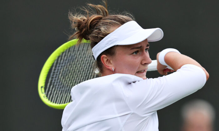 Barbora Krejcikova of The Czech Republic plays a forehand in her Ladies' Singles First Round match against Clara Tauson of Denmark during Day Two of The Championships-Wimbledon 2021 at the All England Lawn Tennis and Croquet Club in London, England, on June 29, 2021. (Clive Brunskill/Getty Images)