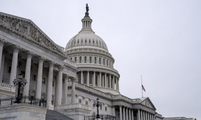 An American flag flies at half staff at the U.S. Capitol in Washington on Jan. 11, 2021. (Stefani Reynolds/Getty Images)
