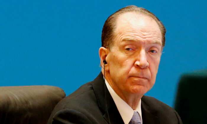 """World Bank President David Malpass attends the """"1+6"""" Roundtable meeting at the Diaoyutai state guesthouse in Beijing, China on Nov. 21, 2019. (Florence Lo/Reuters)"""