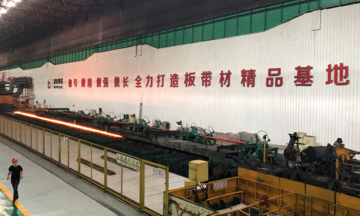 A man walks inside a steel plant of Delong Steel in Xingtai, Hebei province, China on June 20, 2019. (Muyu Xu/File Photo/Reuters)