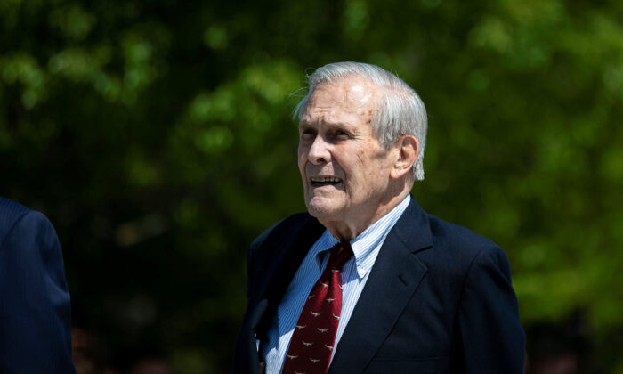 Former U.S. Defense Secretary Donald Rumsfeld looks on after former U.S. President George W. Bush placed a wreath during the 18th anniversary of Sept. 11 attacks at the Pentagon in Arlington, Va., on Sept. 11, 2019. (REUTERS/Al Drago)