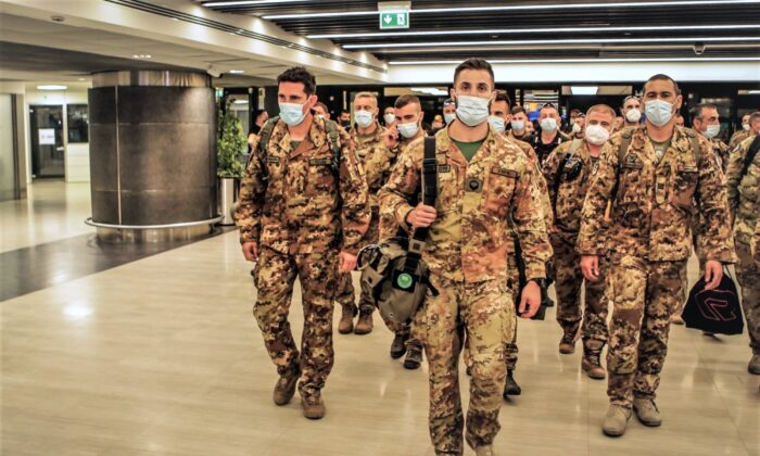 Italian Army soldiers of the last Italian troops withdrawing from Afghanistan walk in the airport in Pisa, Italy, on June 29, 2021. (Italian Defense Ministry via AP)