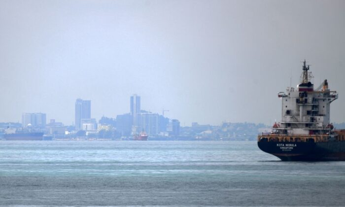 A vessel is seen opposite the Marina Pier in front of Indonesia's Batam island (background) in Singapore on May 2, 2020. (Roslan Rahman/AFP via Getty Images)