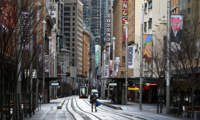A pedestrian moves along an almost empty George Street in the Sydney CBD, Australia on June 28, 2021. (Lisa Maree Williams/Getty Images)