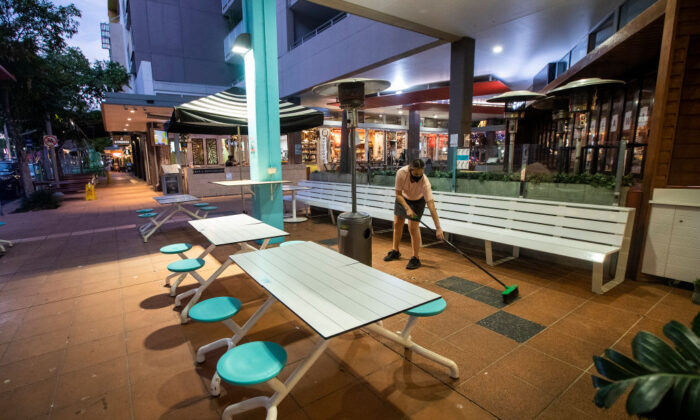 Workers pack up at a cafe in Brisbane, Australia on June 29, 2021. (Jono Searle/Getty Images)