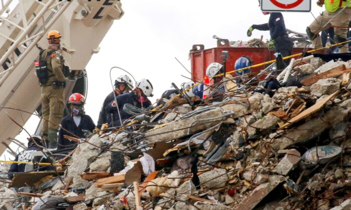 Emergency workers conduct search and rescue efforts at the site of a partially collapsed residential building in Surfside, near Miami Beach, Fla., on June 29, 2021. (Joe Skipper/Reuters)