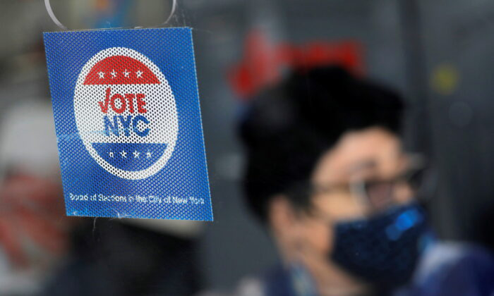Signage at an early voting location ahead of New York's mayoral election in Harlem on June 18, 2021. (Reuters/Andrew Kelly)
