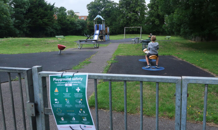 Safety guideline notices are seen at a reopened playground at St. Mary's Field in Wallington, England, on July 4, 2020.  (Mark Trowbridge/Getty Images)