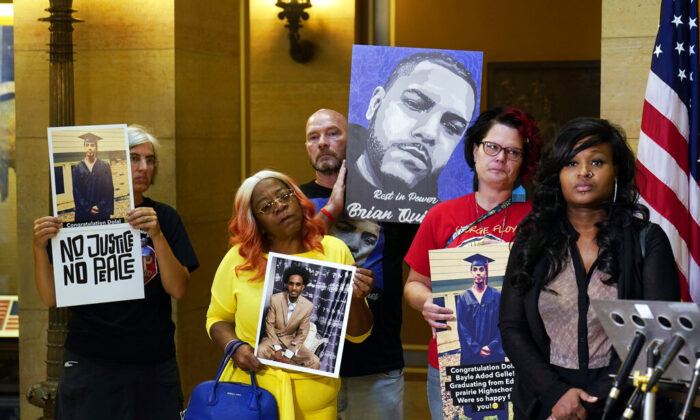 Protesters gathered in the State Capitol rotunda ahead of the debate to urge the Minnesota House to reject the compromise and pass tougher measures in police accountability in the Public Safety Bill, in St. Paul, Minn., on June 29, 2021. (Jim Mone/AP Photo)