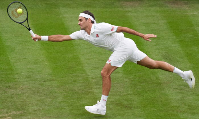Roger Federer of Switzerland during the Men's Singles First Round match during Day Two of The Championships-Wimbledon 2021 at the All England Lawn Tennis and Croquet Club in London, England, on June 29, 2021. (Peter Van den Berg/USA TODAY Sports via Reuters)