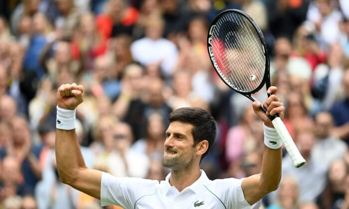 Serbia'a Novak Djokovic celebrates winning his first round match against South Africa's Kevin Anderson during the Wimbledon Championships in London, UK, on June 30, 2021. (Toby Melville/Reuters)