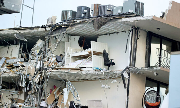 A bunk bed is seen in the rubble at Champlain Towers South Condo in Surfside, located at 8777 Collins Avenue, a part of which collapsed in the early morning in Surfside, Fla., on June 24, 2021. (David Santiago/Miami Herald/TNS)