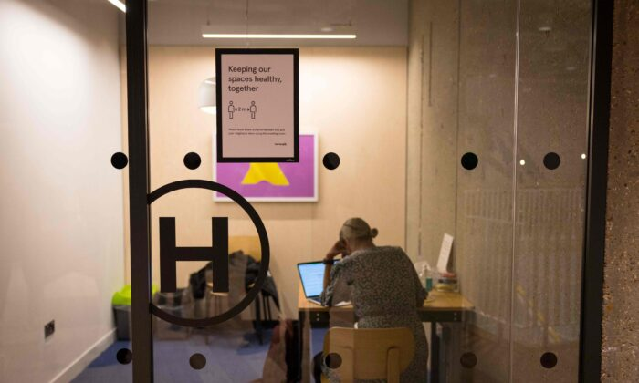 A woman works in a meeting room at the WeWork, in London, on April 13, 2021. (Tolga Akmen/AFP via Getty Images)
