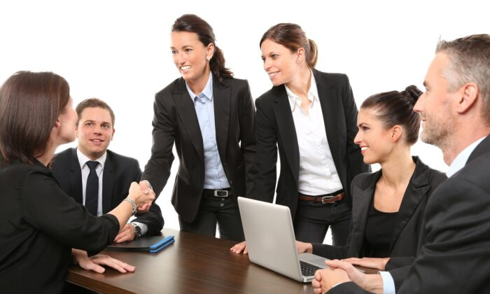 People shake hands during a work meeting in a stock photo. (Pixabay)