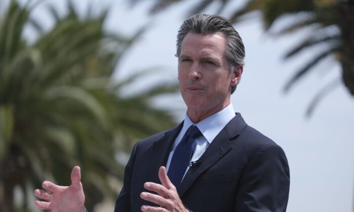 California Governor Gavin Newsom talks during a news conference at Universal Studios in Universal City, Calif. on Tuesday, June 15, 2021. (Ringo H.W. Chiu/AP Photo)
