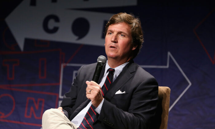 Fox News host Tucker Carlson speaks onstage during Politicon 2018 at Los Angeles Convention Center on Oct. 21, 2018. (Rich Polk/Getty Images for Politicon)