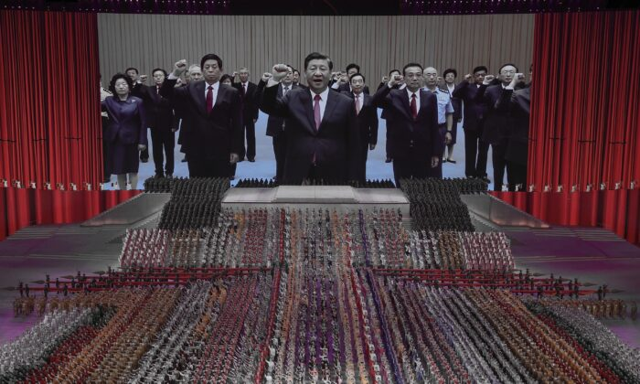 A large screen showing communist officials and Chinese leader Xi Jinping (center) during a mass gala marking the 100th anniversary of the Chinese Communist Party at the Olympic Bird's Nest stadium in Beijing, China on June 28, 2021. (Lintao Zhang/Getty Images)
