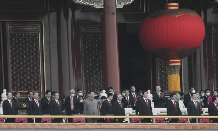 Chinese leader Xi Jinping (C), standing with former leader Hu Jintao, attends the celebration marking the 100th anniversary of the Chinese Communist Party at Tiananmen Square in Beijing on July 1, 2021. (Lintao Zhang/Getty Images)