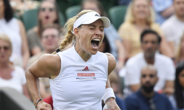 Germany's Angelique Kerber celebrates during her second round match against Spain's Sara Sorribes Tormo during The  Wimbledon Championships at the All England Lawn Tennis and Croquet Club, London, Britain, on July 1, 2021. (Toby Melville/Reuters)