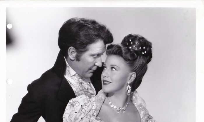 """A publicity shot of Burgess Meredith and Ginger Rogers in """"Magnificent Doll,"""" about Dolley and James Madison. (Universal Pictures)"""