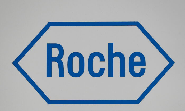A sign at a diagnostics site for Swiss pharmaceutical giant Roche is seen in Burgess Hill, United Kingdom, on Oct. 7, 2020. (Peter Nicholls/Reuters)