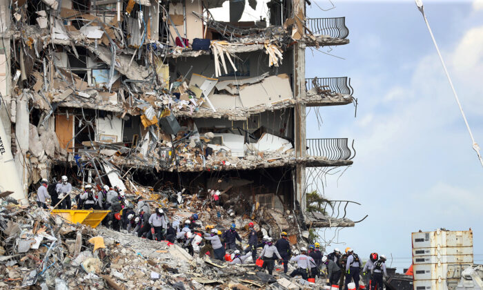 Search and rescue teams look for possible survivors and to recover remains at the site of the 12-story oceanfront Champlain Towers South Condo, at 8777 Collins Ave., that partially collapsed in Surfside, Fla, on June 29, 2021. (Mike Stocker/Sun Sentinel/TNS)