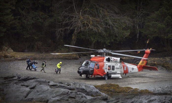 A U.S. Coast Guard helicopter sits in a beach area in this file photo taken on March 28, 2020. (Dustin Safranek/Ketchikan Daily News/Associated Press)