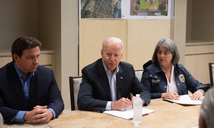 President Joe Biden speaks alongside Miami Dade County Mayor Daniella Levine Cava (R) and Florida Governor Ron DeSantis (L) about the collapse of the 12-story Champlain Towers South condo building. (Saul Loeb/AFP via Getty Images)