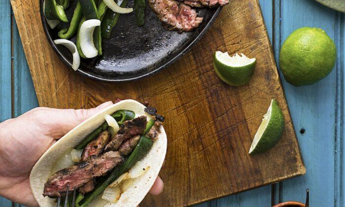 Serve these steak fajitas with fresh pico de gallo, guacamole, and cold beer. (Andrew Scrivani/TNS)